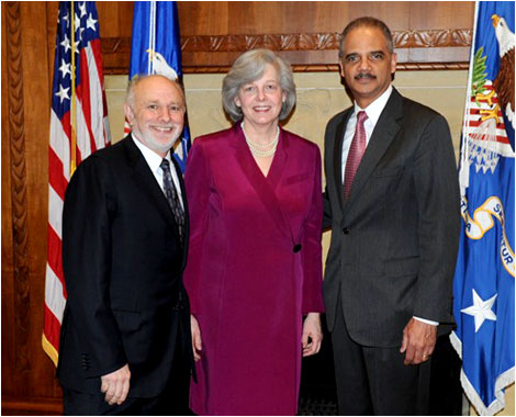 (L-R) Assistant Attorney General William J. Baer, his wife Nancy H. Hendry, and Attorney General Eric Holder.