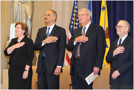 Former Acting Assistant Attorney General Sharis A. Pozen, Attorney General Eric Holder, former Assistant Attorney General James F. Rill, and U.S. Court of Appeals Circuit Judge Michael Boudin stand for the national anthem.