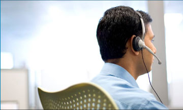 Photo of a man with telephone headphone.