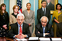 (Seated L-R) Acting Assistant Attorney General Joe Wayland and Chairman Ashok Chawla of the Competition Commission of India speak after signing the Memorandum of Understanding (MOU) on Antitrust Competition in September 2012. (Standing L-R) Department of State Deputy Assistant Secretary Alyssa Ayres; Department of Justice Special Advisor, International, Rachael Brandenburg; Department of Justice Deputy Assistant Attorney General Leslie Overton; Minister of Pers. and Community Affairs,  Embassy of India, Datta Padsalgikar; and Counselor, Economic, Embassy of India, Sukriti Likhi.