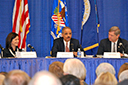Assistant Attorney General Christine Varney, U.S. Attorney General Eric Holder, and Agriculture Secretary Tom Vilsack speak at the first joint DOJ/USDA agriculture workshop in Iowa.