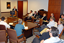 Assistant Chief Howard Blumenthal gives a presentation to Deputy Assistant Attorney General Scott D. Hammond (seated immediately to Mr. Blumenthal's left) and other Division managers and staff.