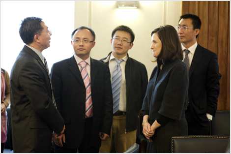 Assistant Attorney General Christine Varney meets with Chinese officials.