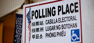 photograph of a multilingual polling place sign
