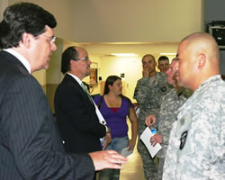 photograph of servicemembers with Assistant Attorney General Perez and U.S. Attorney Hale