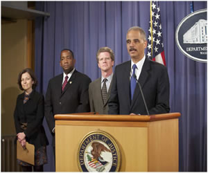 photograph of Attorney General Holder speaking at a podium