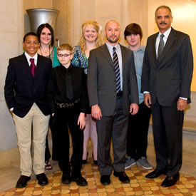 photograph of Attorney General Eric Holder and students from Anoka-Hennepin