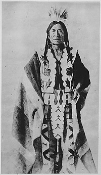 Rocky Boy (Stone Child), a Chippewa chief; three--quarter-length, standing, dressed in ornate costume. Courtesy of the National Archives.