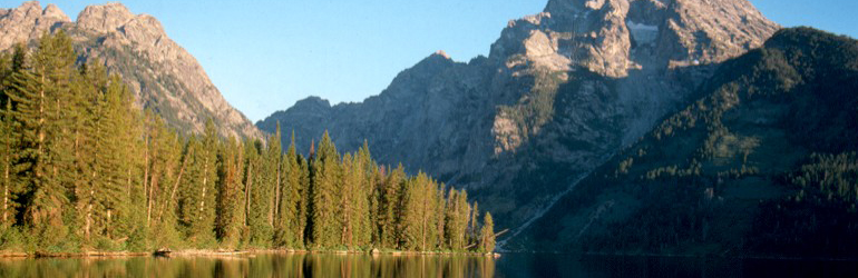 Photograph of a lake with mountains on the background at Grand Teton National Park.  Courtesy of the National Park Service.