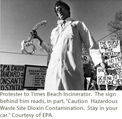 Protester to Times Beach Incinerator.  The sign behind him reads, in part,