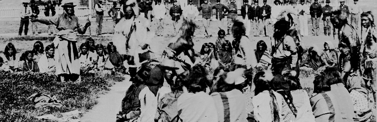 Shoshone Indians at Ft. Washakie, Wyoming Indian reservation .. . Chief Washakie (at left) extends his right arm.