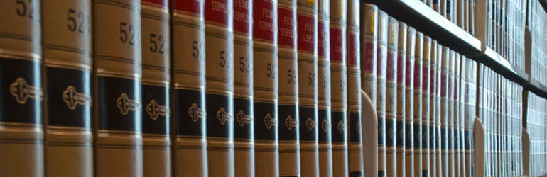 Stack of case law books on  a shelve at the Patrick Henry Library.