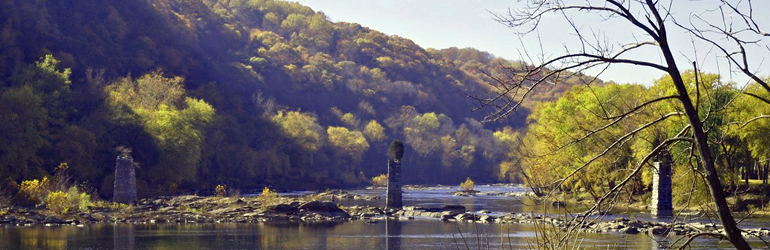 A rivers flows through Harpers Ferry.  Courtesy of Ned Wolff (DOJ)