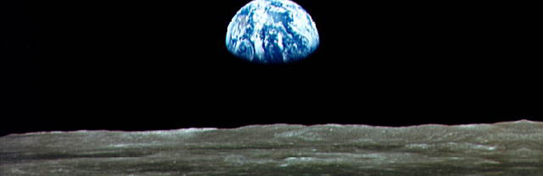 On July 20, 1969, after a four day trip, the Apollo astronauts arrived at the Moon. This photo of Earthrise over the lunar horizon was taken from the orbiting Command Module. Courtesy of NASA.