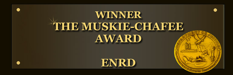 A graphic displaying the letters Winner The Muskie-Chafee Award with ENRD's seal at bottom right