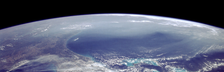 This photograph taken by NASA shows a cloud of smog hugging the circumference of earth.  Courtesy of NASA.