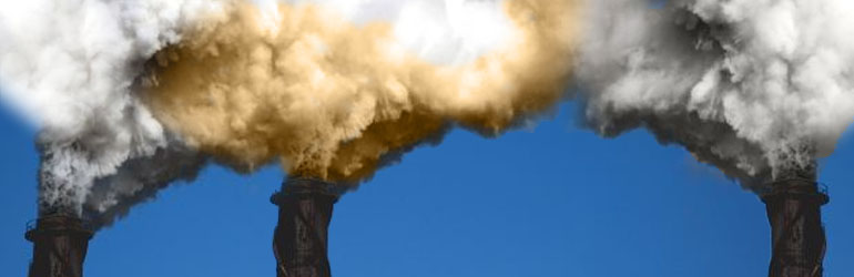 Smokes stacks spewing pollutants into the air.