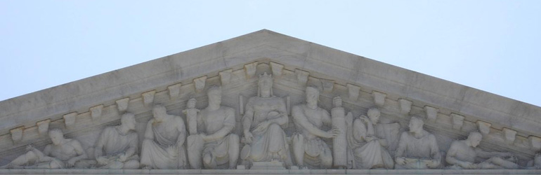 Close view of the top of the Supreme Court Building in Washington DC. Courtesy of US Courts.