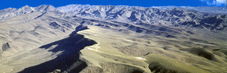 Yucca Mountain as seen from the south. The ridge in the center is the site of the proposed nuclear waste repository. Photo courtesy of U. S. Department of Energy.
