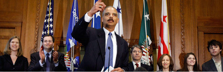 Photo of Attorney General Eric Holder flanked by Deputy Attorney General David Ogden and Associate Attorney General Tom Perrelli