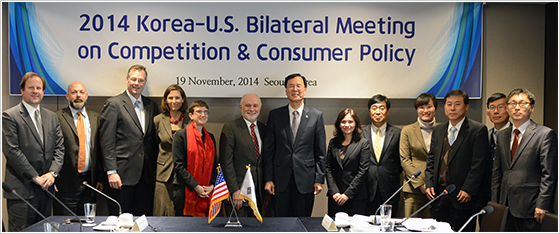 Senior officials from the Department of Justice, the FTC, and the KFTC at a bilateral meeting