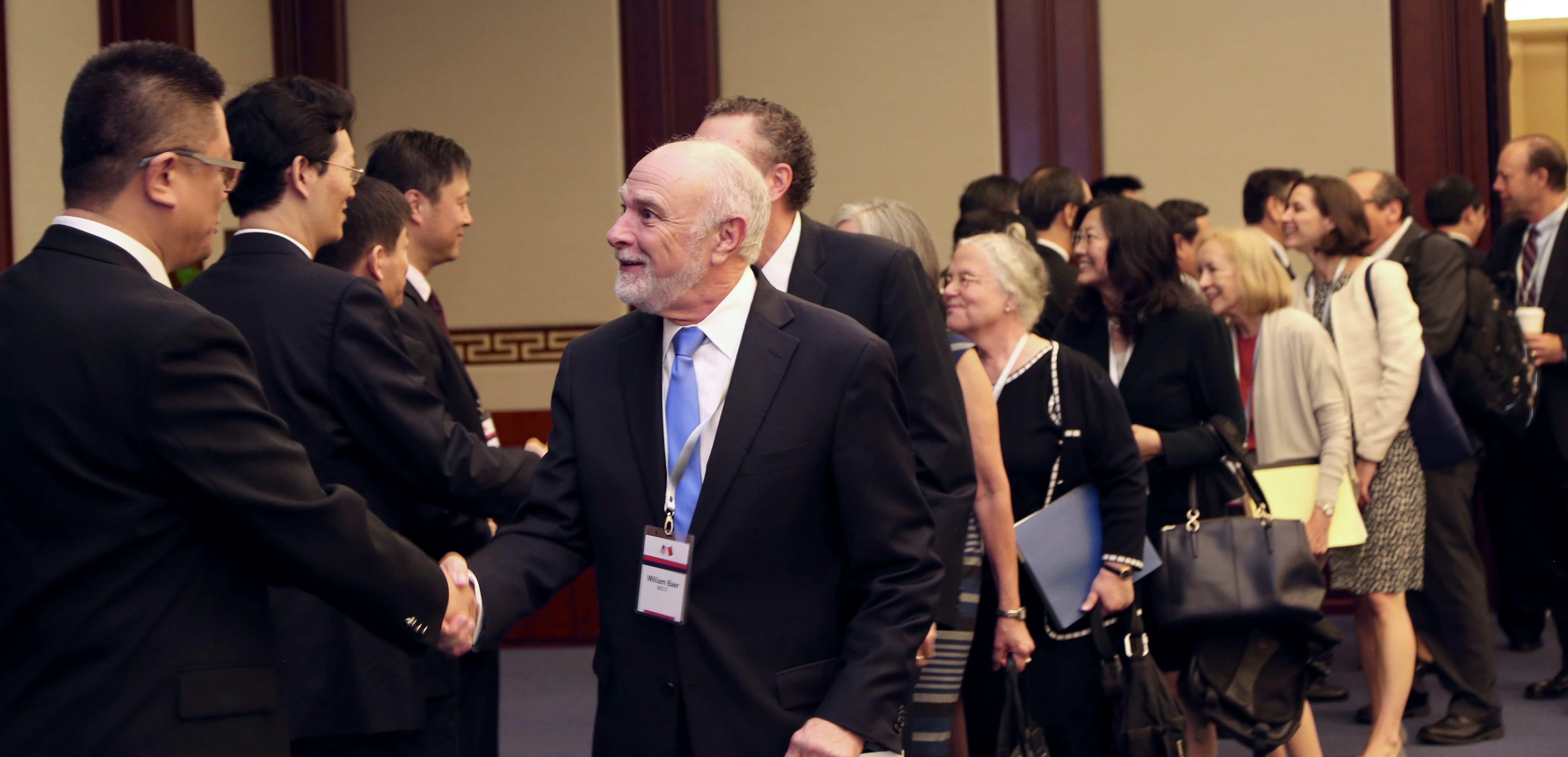 Principal Deputy Associate Attorney General Bill Baer greets Jiang Wei, the Vice Chairman of the Central Leading Group on Judicial System Reform of the Communist Party of China, at the dialogue, which took place Aug. 3 and 4 in Beijing.  The U.S. delegation included officials from the Departments of Justice, Commerce and State and from the Office of the U.S. Trade Representative.  (Photo by Jake Miller, U.S. Department of State)