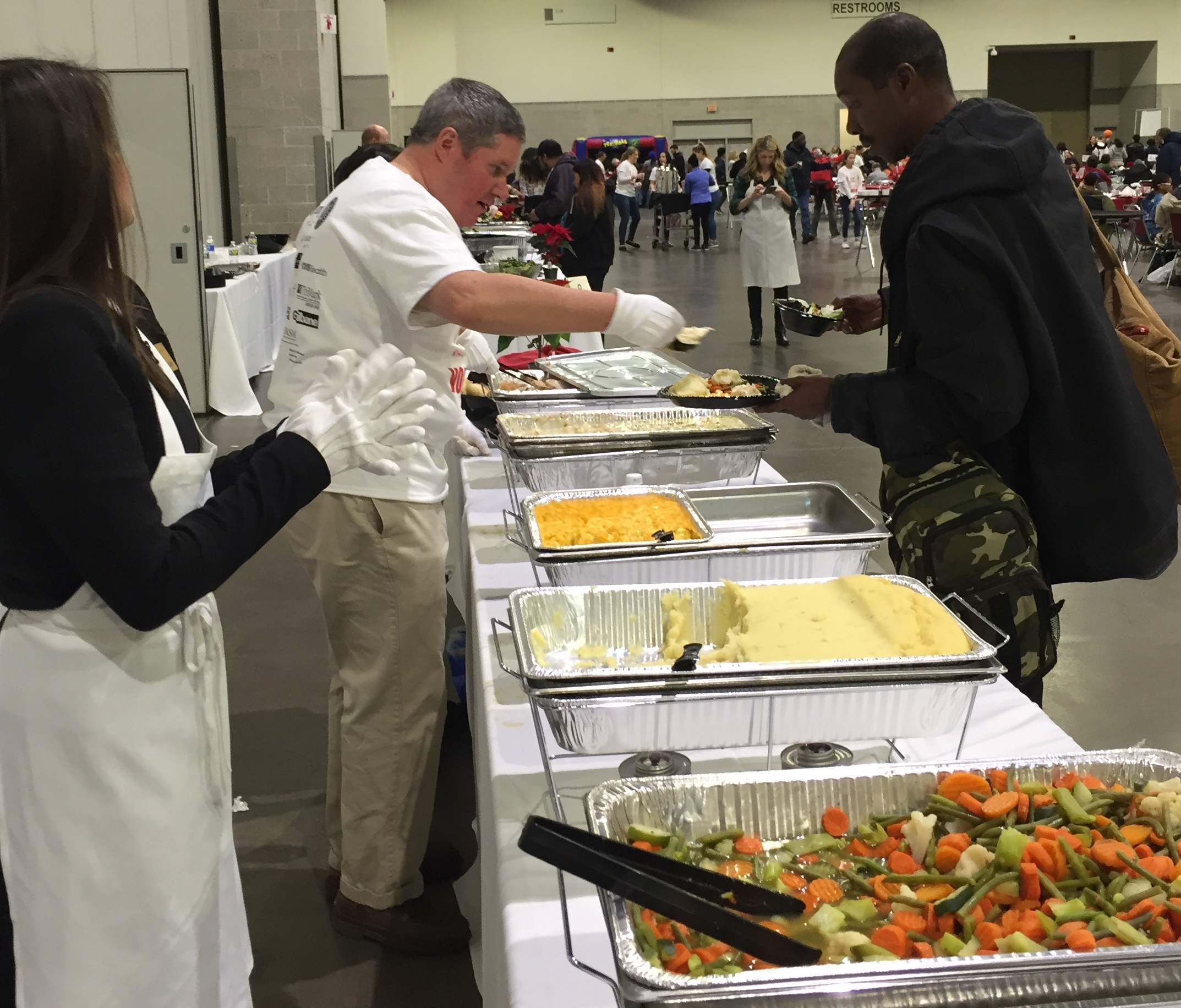 The US Attorney's Office was among those helping to serve a hot meal and provide warm clothing to 2,000 people