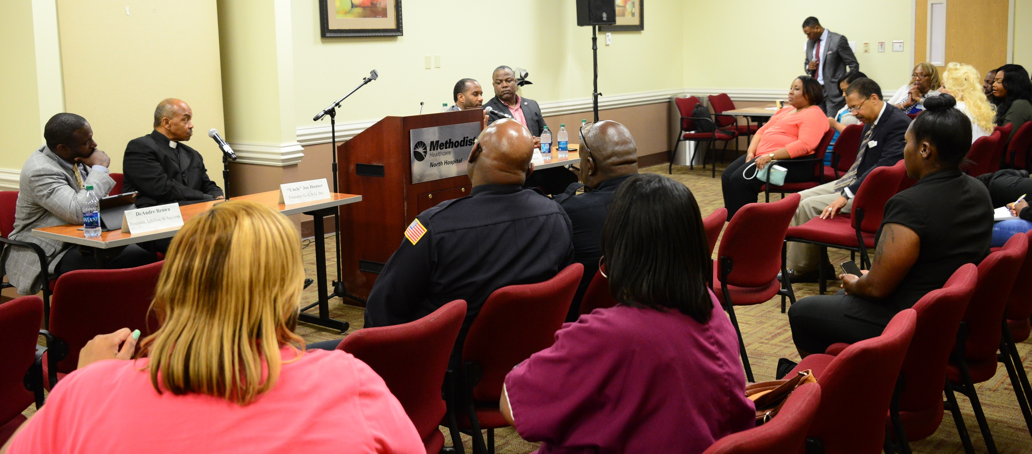 U.S. Attorney Stanton talks to community residents during Violence Prevention Forum.