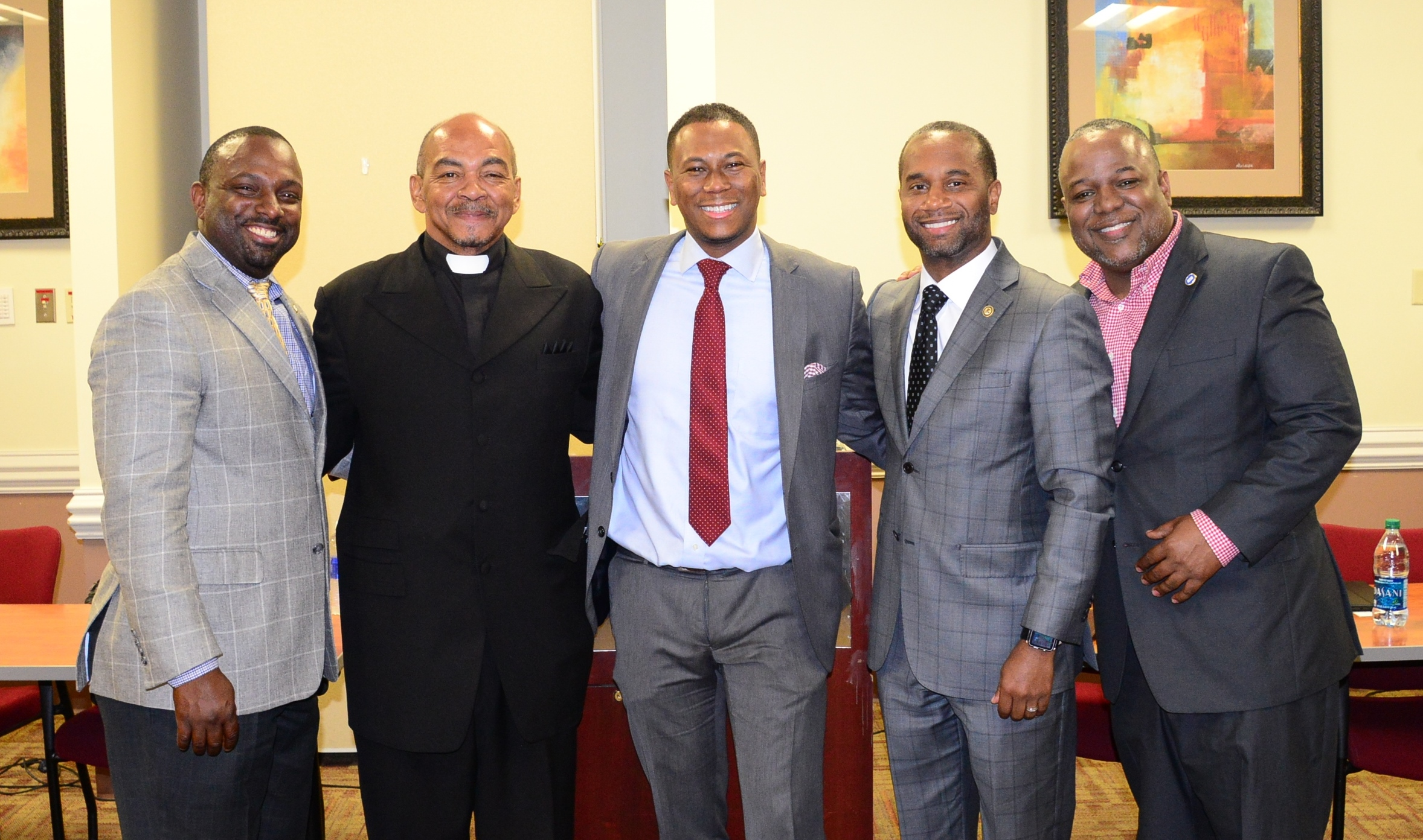 "U.S. Attorney Stanton stands with DeAndre Brown (far L), ""Uncle"" Joe Hunter (L), Gyasi Chisley (M), and Antonio Parkinson (R)."