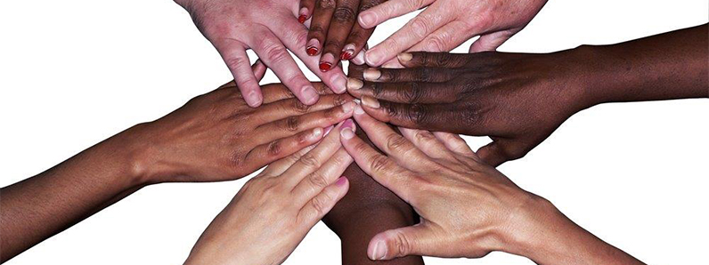 A collective image of hands coming together of all races and ethnicities