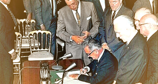 President Johnson signing Title VI in 1964