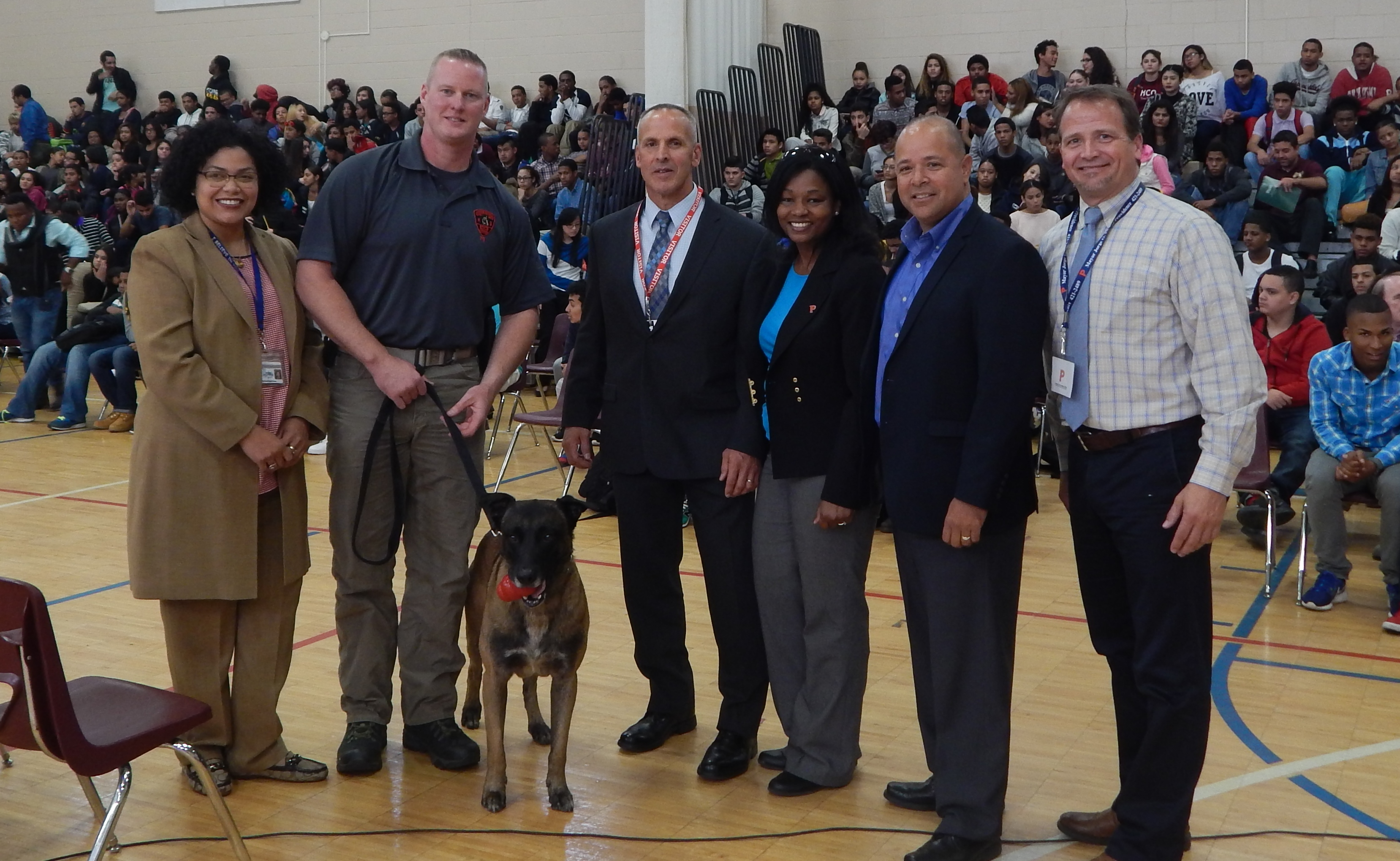 R.I. State Police Detective Sean McGehearty and his K9 Bane demonstrated for students and administrators at the Dr. Jorge Alvarez High School in Providence the training and technique to alert investigators to the presence of drugs