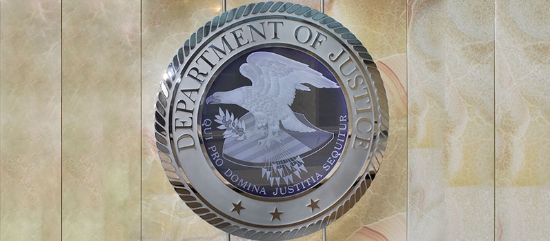 A photo of a U.S. Department of Justice Seal in the lobby of one of its buildings.