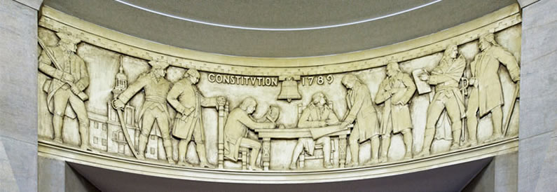 Photograph of relief artwork in the Department of Justice depicting the signing of the Constitution