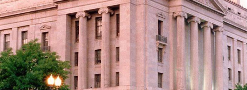 Photograph taken at dusk of the Department of Justice building