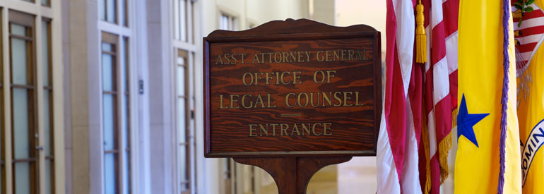 Office of Legal Counsel wooden door sign