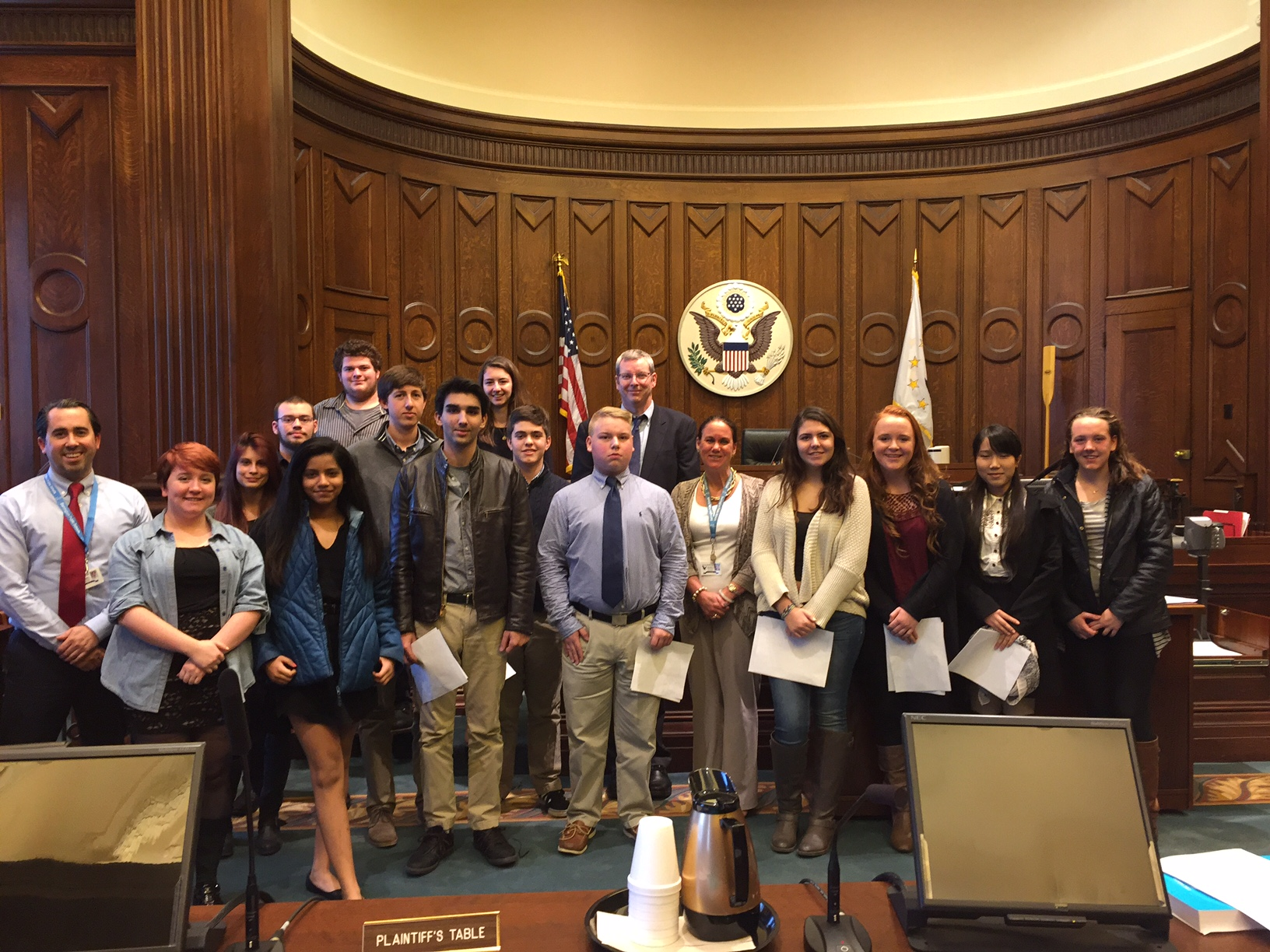 Oana Groza, second from the left in the rear, and her senior class from Barrington High School with U.S. District Court Magistrate Judge Lincoln D. Almond