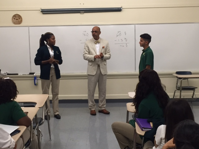 Assistant U.S. Attorney Richard W. Rose with students at St. Patrick Academy in Providence
