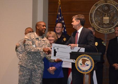 USA presents funds to Florida National Guard Counterdrug Program representatives.