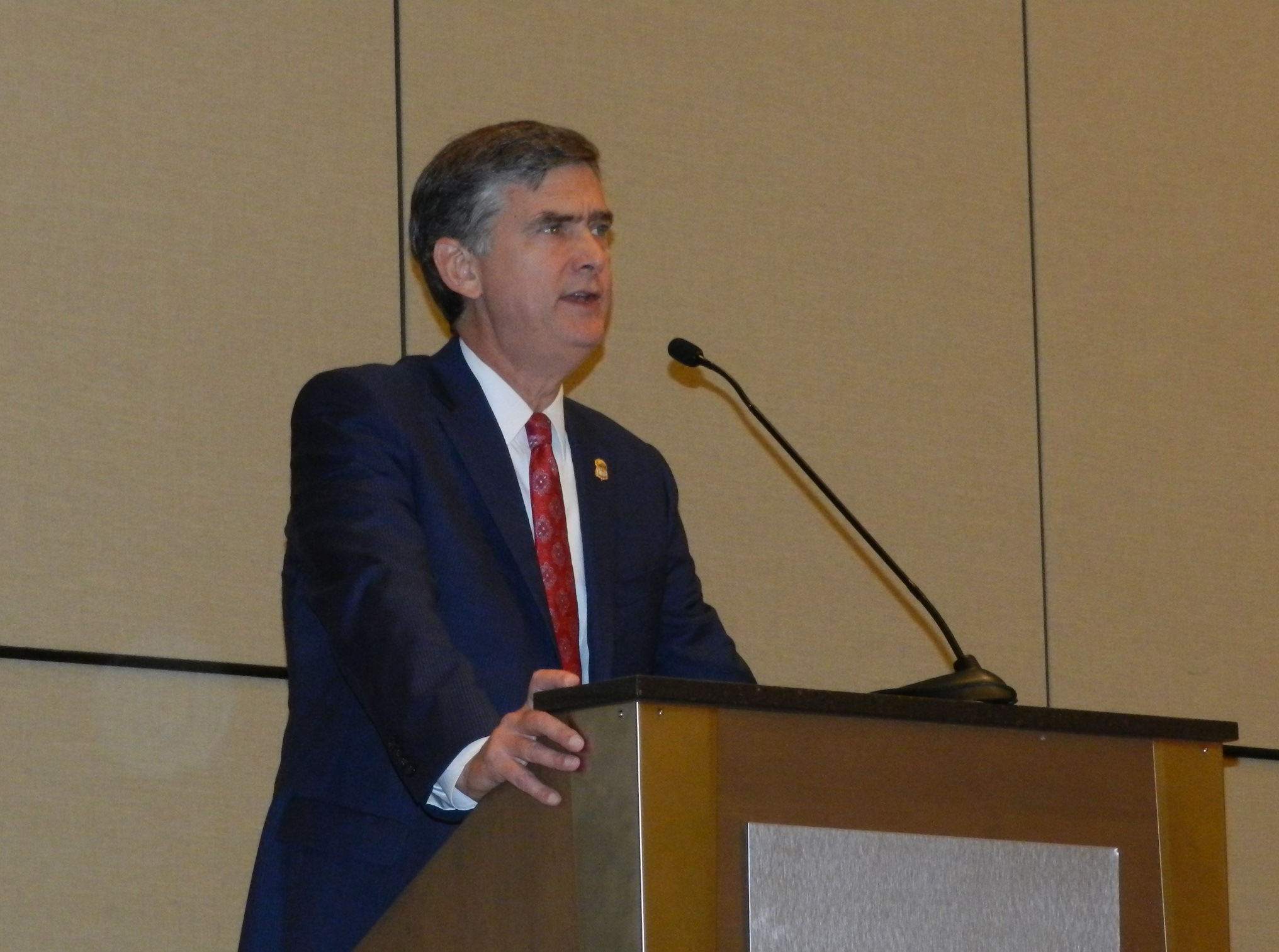 U.S. Attorney speaks during NAACP Conference.