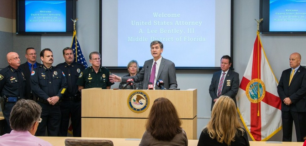 U.S. Attorney presents checks to law enforcement partners.