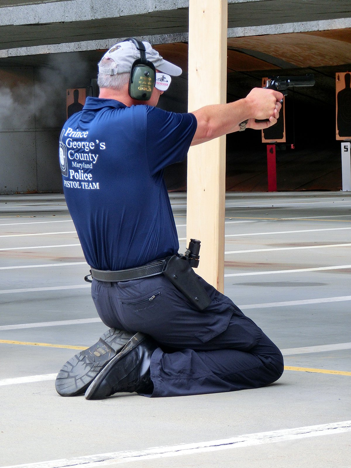 A Prince George's County Police Department competitor participates in the Pistol Action Combat event at the 2015 World Police and Fire Games