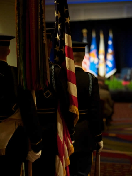 View from behind the color guard as they enter for the commencement of the ceremony.