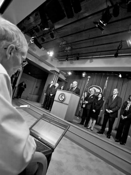 FBI Director Robert S. Mueller III addressing the media at the Stolen Dreams press conference.