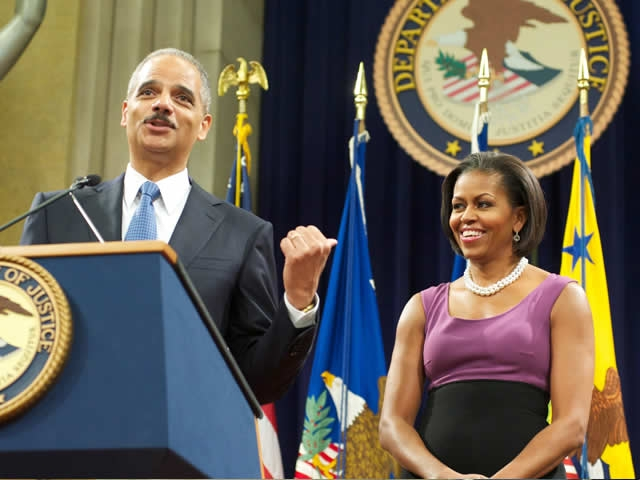 AG Holder introduced the First Lady noting her 'brilliant legal mind, I have been so impressed by her legal skills.