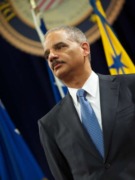 Attorney General Holder looks on as the First Lady addresses Department employees in Great Hall that is packed to capacity.