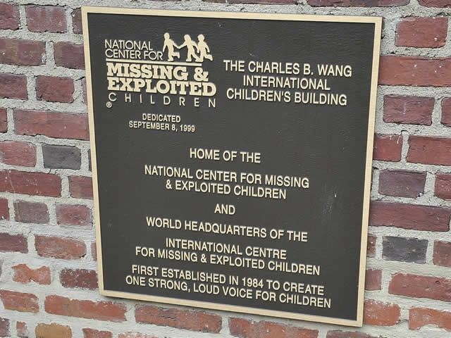 Plaque marking the home of the National Center for Missing and Exploited Children and the location of the press conference.