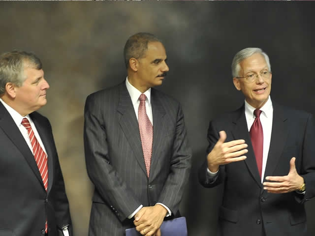 Attorney General Holder flanked by Acting Deputy Attorney General Grindler and Ernie Allen, President and CEO of the National Center for Missing and Exploited Children discuss the role of nonprofits as they wait for the press conference to begin.
