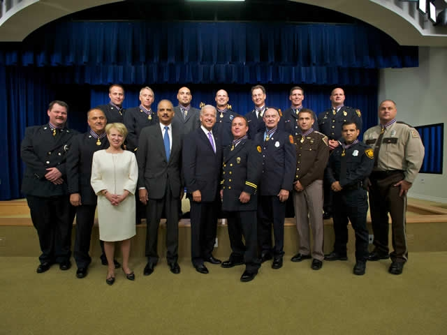Vice President Biden, Attorney General Holder, and Assistant Attorney General Robinson pose with the 14 Medal of Valor Award winners for 2010.