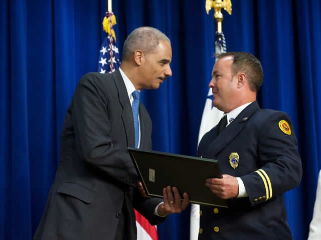 Captain Edwin Lynn O'Berry of Palm Beach County, FL receives his award certificate from the Attorney General.